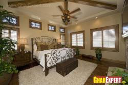 Bedroom decorated in antique style and wooden batten on ceiling