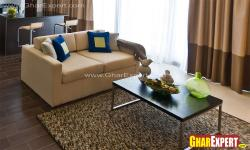 Upholstered sofa and wooden table for living room