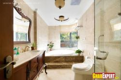 Large bathroom interior with bath tub, vanity and shower enclosure