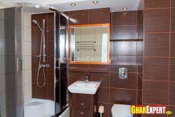 Bathroom inteior with tile cladding on walls