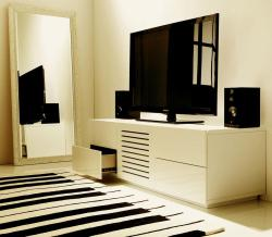 entertainment unit in white enhaanced with rug on the floor