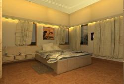 interiors of a large bedroom with cove lights above the curtain