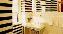 yellow and brown striped wall paint for bathroom