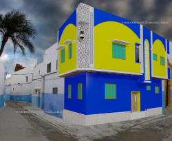 Arabic Style elevation design with  blue and yellow on Exterior facade