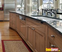 wooden kitchen cabinets with granite countertop and ceramic sink