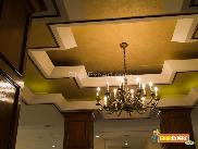 Brass chandelier on ceiling