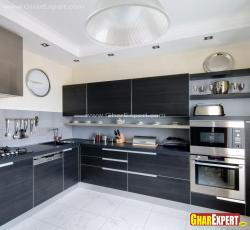 Fully equipped modern italian kitchen with dark color veneer and steel accessories