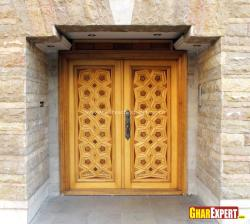 Crafted five to six feet wide wooden door for entrance