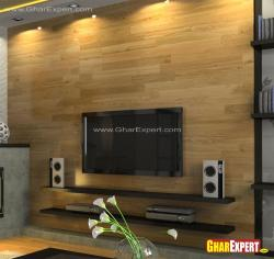 wall mounted LCD and shelves for speakers