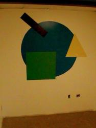 paint design with colorful geometrical shapes on wall