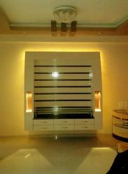 Backlit high glow LCD unit design for a living room done with white laminates