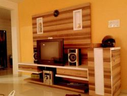 tv wall unit design covering entire wall with place for Music system and DVD player