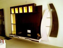 artistic wall tv unit in wood with  horizontal and vertical cove design
