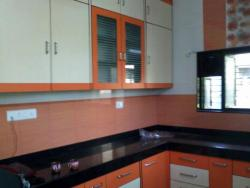 compact kitchen picture with pink tiles on wall