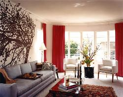 A beautiful drawing room design with good ceiling and wall decor
