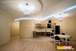 L shaped open kitchen with lighting effect through coves