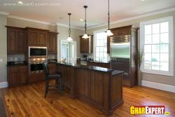 steel appliances and wooden cabinetrs in large spacious kitchen