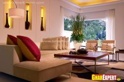 Living room design using Niches that glow in soft golden light Modern furniture to enhance the decor