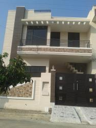 Simple cost effective elevation design for a two storey home using modern color combination