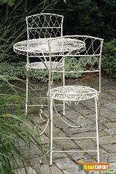 Sleek Iron Chairs With a Beautiful Table