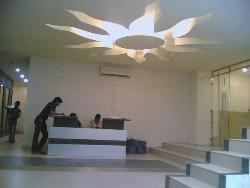 Sun shaped ceiling design in a reception