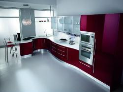 Modular kitchen design with red color combo.