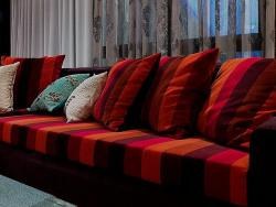 colorful couch with striped cushions