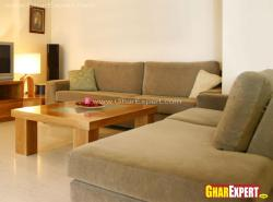 Brown upholstered sofa set with wooden center table