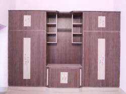 wardrobe designs for bedroom using laminates and place for TV