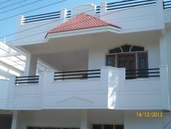 A Duplex house ,Balcony with Sloped roof &Wooden door/window frames