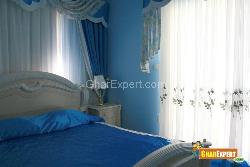 Stylish Bedroom Curtains & a Side Table with Lamp