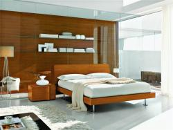 Nice Bedroom with wooden cladding on one wall