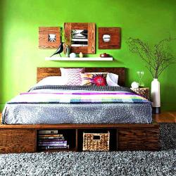 Platform bed design with a background green paint
