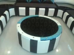 A designer center table custom made by Interior Designer to match the sofa