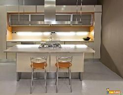 New light kitchen with counter and chairs
