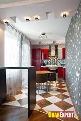 L shaped small kitchen with four seat dining space