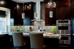 Steel Kitchen accessories in a modern kitchen designed with dark colored cabinets