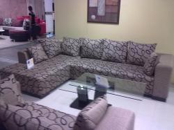 Cushioned sofa as available