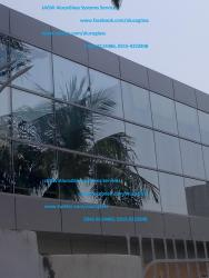 Curtain Wall, Tempered Glass and Aluminum Composite Panel at Exterior of E