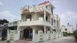 Duplex house,4bhk,corner plot, with SS Railing,Wooden door/windows, sloped roof balcony,decorative porch ceiling, MS Gate, grill and compound wall.