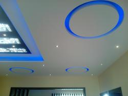 Ceiling with blue cove lights and circular concept