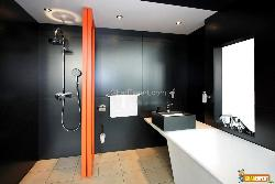 Bathroom With Orange Divider