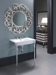 wash basin in chrome finish and elaborate mirror design