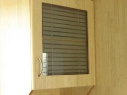 Kitchen wall cabinet with etched glass shutter