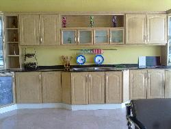 wooden kitchen with granite counter top