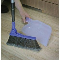 Cleaning of wooden floor with Broom