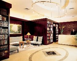 hotel lobby with small library and seating