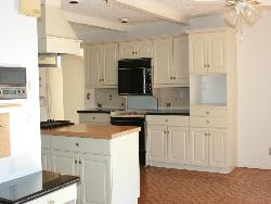 White colored cabinetry in modern kitchen