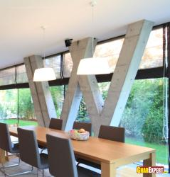 Slanted pillar design in glass wall