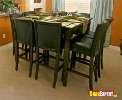 Black leather upholstered wooden dining chair and table